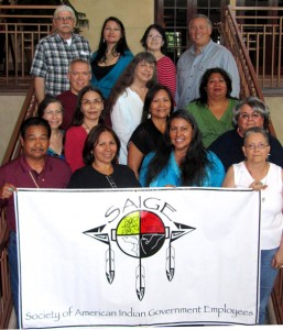 SAIGE 2012 Board of Directors L-R, Top Row: Les Tate, Elder; Shana Barehand, Becky Lewis, Danny Garceau. Next Row: Phil Hamel, Lori WIndle, Veronica Vasquez; Next Row:Sue Marcus, Brenda Takes Horse, Millie Titla, Fredericka Joseph. Front Row: Pete Molina, Sue Morris, Susan Johnson, Jinny Shulenberger. SAIGE Board Photo taken June 8, 2012 in Broomfield, CO.